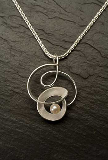 Sterling-Silver-and-Pearl-Knot-Necklace.jpg
